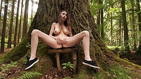Fidgety girl with big naturals, seductive solo into the woods