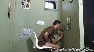 Latino gay dude sucks and plays with a big black glory hole cock